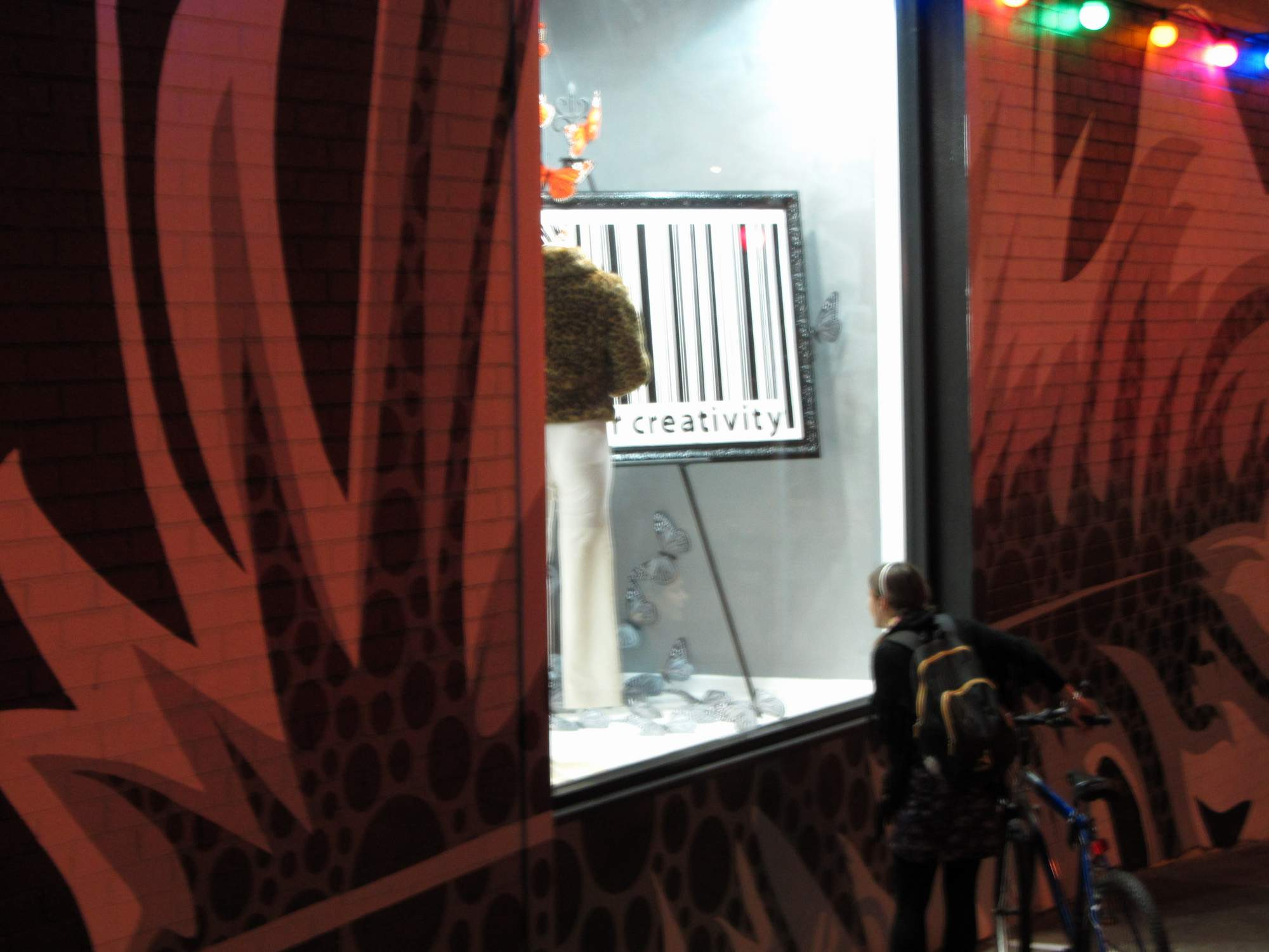 Cyclist takes a closer look of Release your Creativity window July VM+