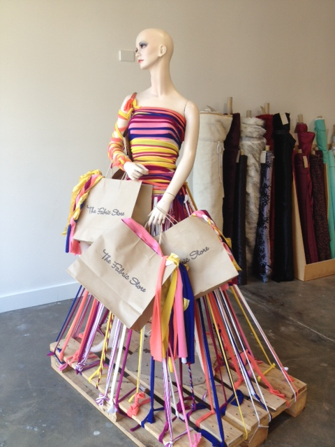 Mannequin standing on pallet with string skirt. Visual merchandising in Brisbane
