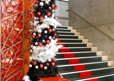 Emporium Brisbane black slimline with red baubles and silver feather detail trim