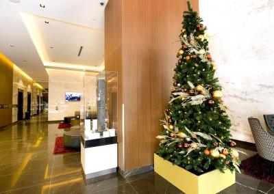 Meriton Herschel St Brisbane gold tree box with gold metallic feather decorations