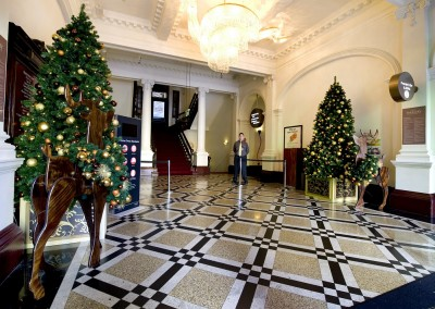 Treasury Casino Brisbane foyer Christmas trees with wooden reindeer bedecked in Christmas wreaths