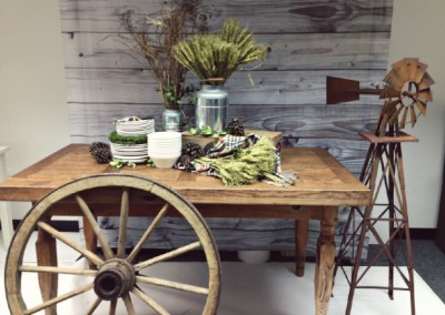 Retail  homewares display green wheat and rustic table setting