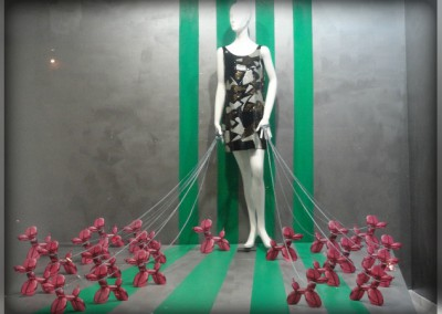 VM window dressing display fashion green stripes and pink balloon dogs